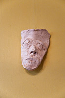 Face built up with small pieces of clay, Unfired